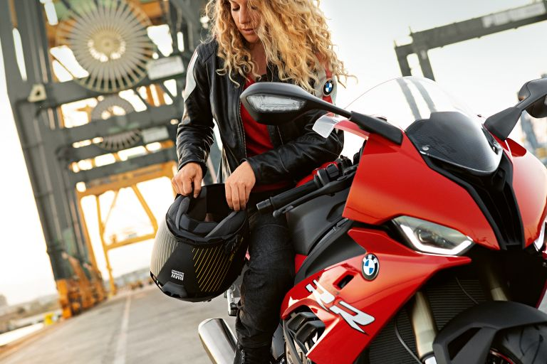 BMW S 1000 RR with female driver on a bridge