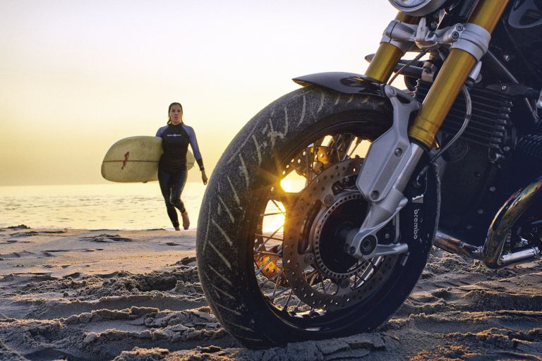 Surfing on the beach with BMW Motorrad in section.