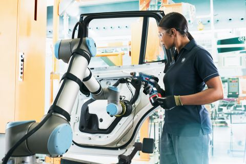 BMW Group employees work alongside robots.